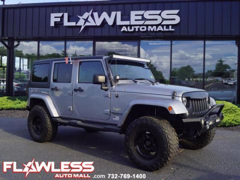 Pre-Owned 2015 Jeep Wrangler Unlimited SAHARA LIFTED